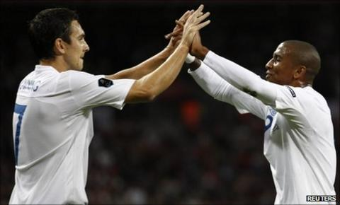 Ashley Young celebrates his goal with Stewart Downing