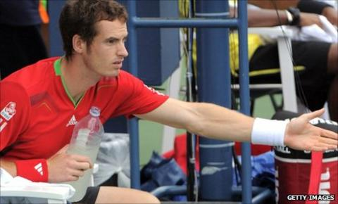 Andy Murray and match officials discuss the state of the court