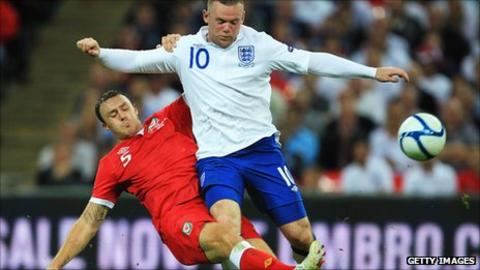 Darcy Blake in action against England's Wayne Rooney