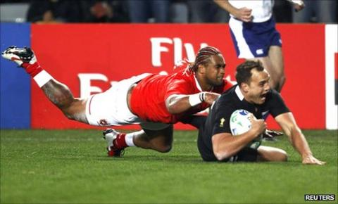 Israel Dagg, who collected two tries, dives over to score for New Zealand
