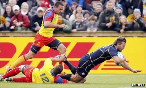 Scotland's Simon Danielli (right) scores a try as Romania's Madalin Lemnaru and Ionut Dimofte fail to tackle him