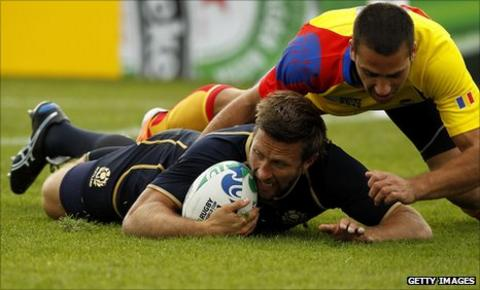 Simon Danielli crashes over for a try against Romania