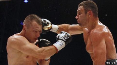 Vitali Klitschko (right) was too powerful for Tomasz Adamek