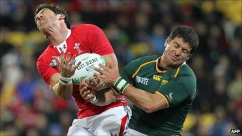 Wales full-back James Hook competes for the ball with South Africa fly-half Morne Steyn