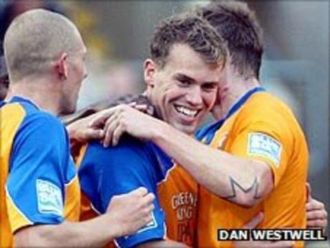 Mansfield players celebrate another goal in the win over Newport