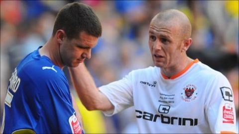 Cardiff City's Anthony Gerrard is consoled by Blackpool's Stephen Crainey at the end of the play-off final