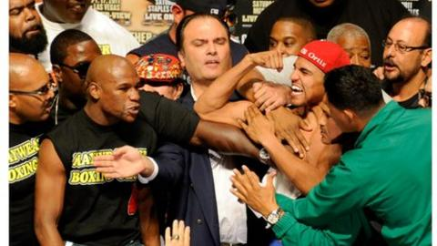 Floyd Mayweather Jnr (left) and Victor Ortiz (right)