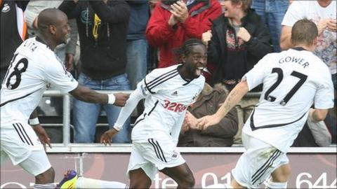 Nathan Dyer celebrates after scoring Swansea City's third goal against West Brom
