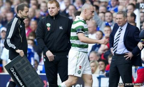 Scott Brown trudges off during Celtic's defeat at Ibrox