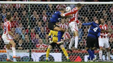 Peter Crouch heads Stoke City level against Manchester United