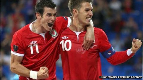 Gareth Bale and Aaron Ramsey celebrate against Montenegro