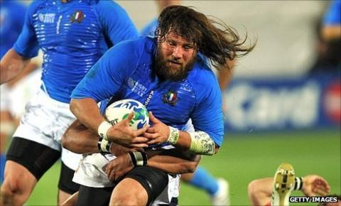 Italy's Martin Castrogiovanni carries the ball against the United States