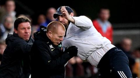 A fan attacks Celtic manager Neil Lennon at Tynecastle