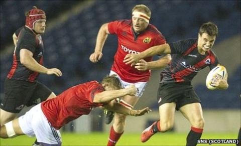 Matt Scott escapes the clutches of Munster