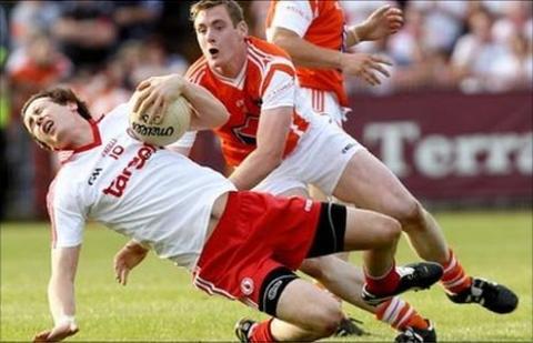 Tyrone's Colm Cavanagh and Armagh's Kieran Toner