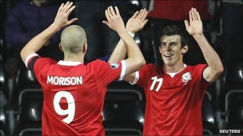 Wales striker Steve Morison congratulates goal-scorer Gareth Bale