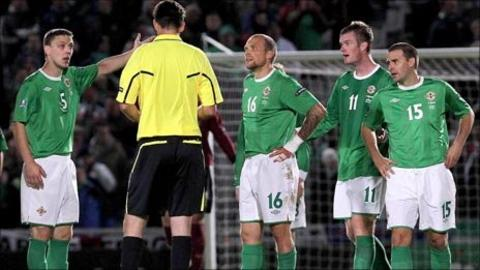 NI players confront the referee