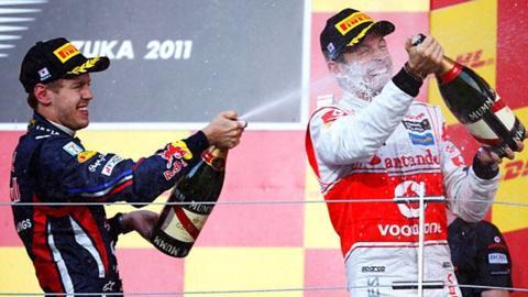 Red Bull's Sebastian Vettel and McLaren's Jenson Button celebrate