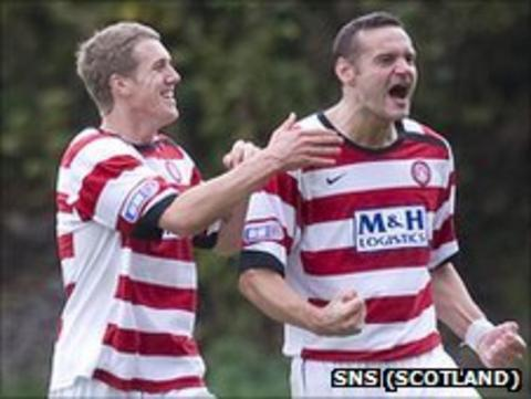 Hamilton's Mark McLaughlin celebrates with a team-mate after scoring against Livingston