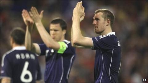 Darren Fletcher (right) and Gary Caldwell (centre) applaud the travelling Scotland fans