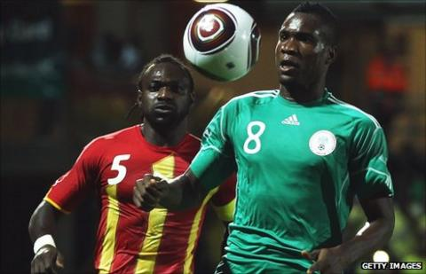 Ghana's John Mensah and Nigeria striker Ideye Brown (right)