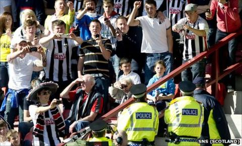 Dunfermline supporters and Fife Police take pictures of each other