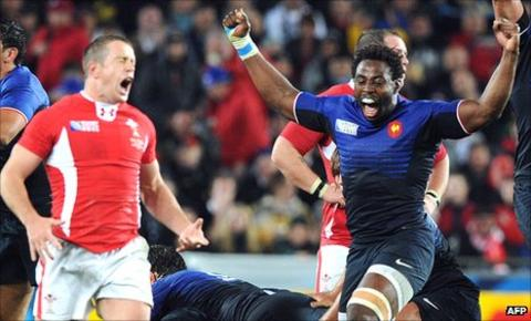 Wales winger Shane Williams despairs as France back rower Fulgence Ouedraogo celebrates the final whistle