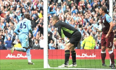 Mario Balotelli puts Manchester City ahead against Aston villa