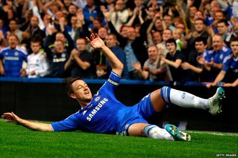 John Terry celebrates his headed goal