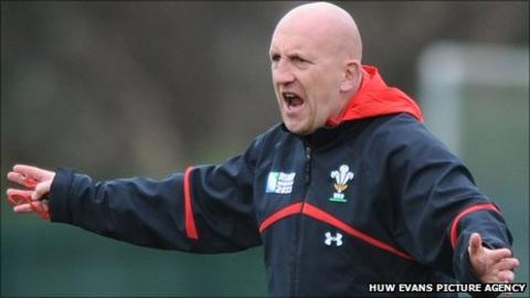 Wales defence coach Shaun Edwards makes a point during training
