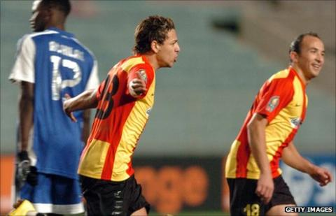 Youssef Msakni (left) and Wajdi Bouazzi celebrate the former's goal