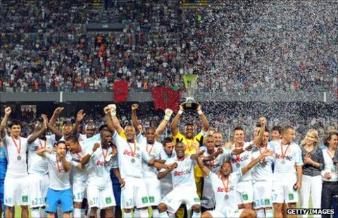 Marseille players celebrate winning the Champions Trophy in July