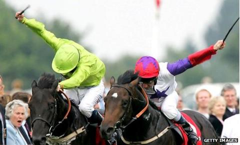 Jockeys use whips at Doncaster races