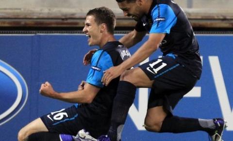 Aaron Ramsey (left) celebrates scoring the winner