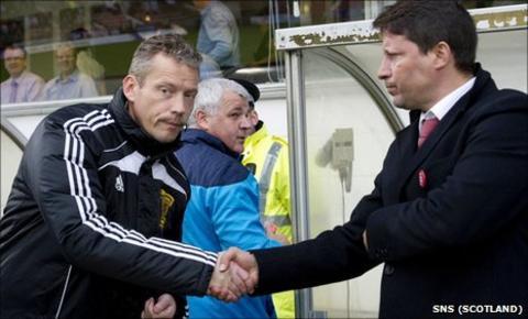 Iain Brines shakes Paulo Sergio's hand before Hearts' match against Dunfermline