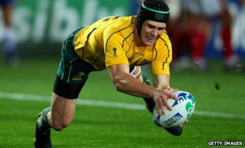 Berrick Barnes touches down for Australia's opening try