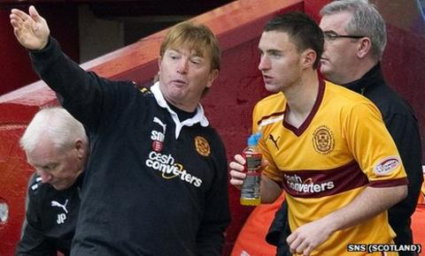 Stuart McCall passes on instructions to substitute Bob McHugh