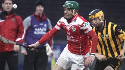 Loughgiel's Joey Scullion moves clear of Patrick Hughes in the Ulster final