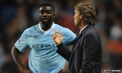 Kolo Toure and Man City boss Roberto Mancini