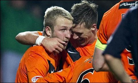 Johnny Russell (left) celebates