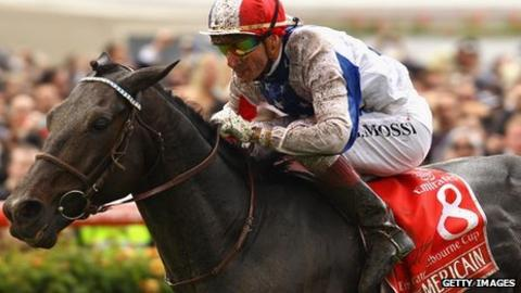 Americain being ridden to victory by Gerald Mosse at the 2010 Melbourne Cup