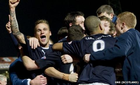 Falkirk celebrate their League Cup win at Tannadice