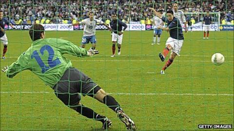 France's Samir Nasri scores a penalty past Asmir Begovic in Bosnia's final group match