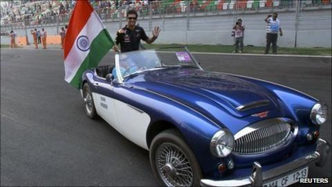 Webber waves an Indian flag during the driver parade at the Buddh International Circuit