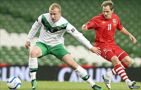 Liam Boyce in action for Northern Ireland against David Vaughan of Wales
