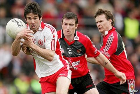 Tyrone's Ciaran Gourley in action against Liam Doyle and Daniel McCartan of Down