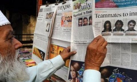 A man browsing newspapers in Pakistan
