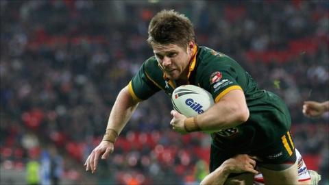 Australia's Chris Lawrence scores a try