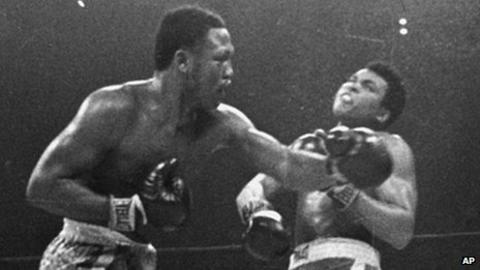 Joe Frazier hits Muhammad Ali with a left during their heavyweight title fight in 1971