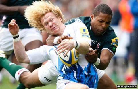 Tom Biggs (left) is tackled by Delon Armitage